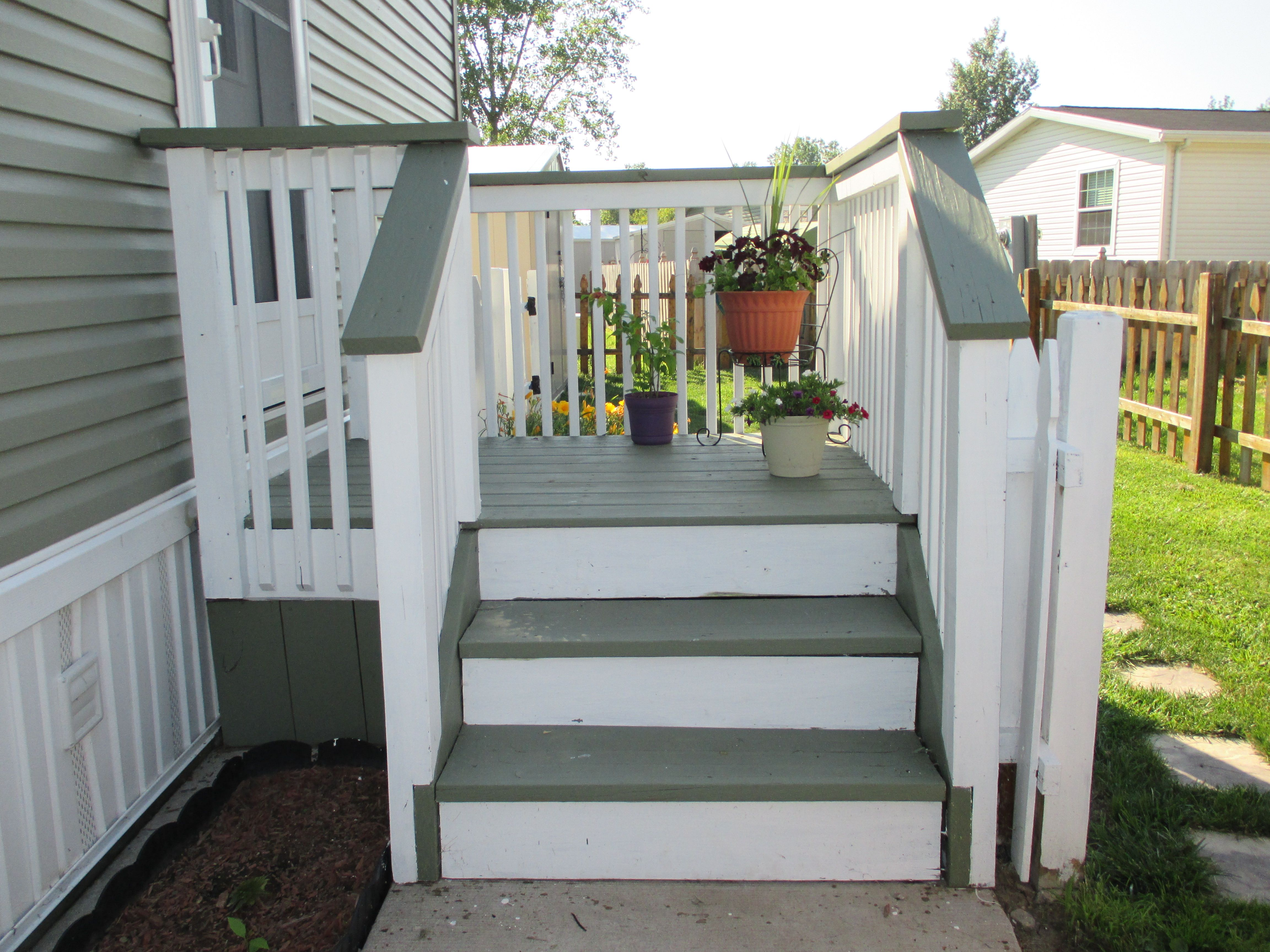 My side entrance deck porch re stained with two behr solid for Side porch