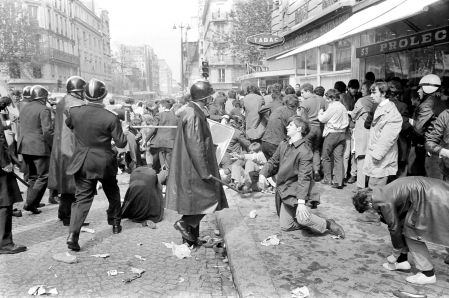 Police officers, members of the riot police, wielding batons rue Saint-Jacques in Paris during clashes between protesters and security forces in the Latin Quarter May 6, 1968, during the events of May 68. the demonstrations, which were banned, took a violent turn during the afternoon and ended the evening in an atmosphere of rioting.
