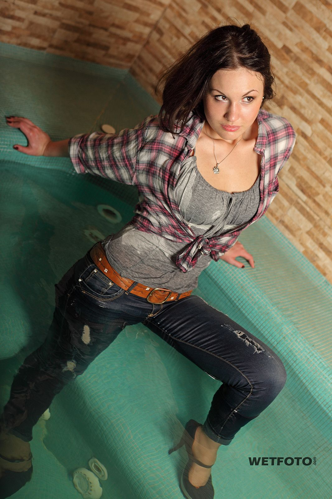 257 wetlook with sexy girl in wet tight jeans. beautiful brunette in