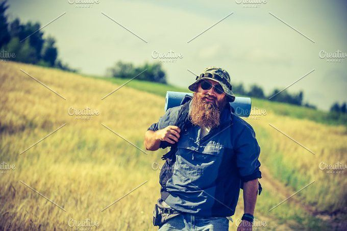 man goes camping. People Photos. $6.00