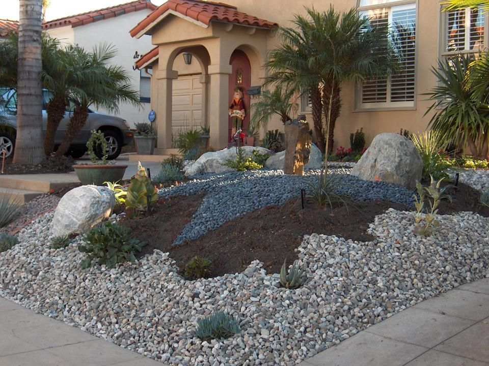 Low water usage plants in pots gives your xeriscaped yard a unique look.