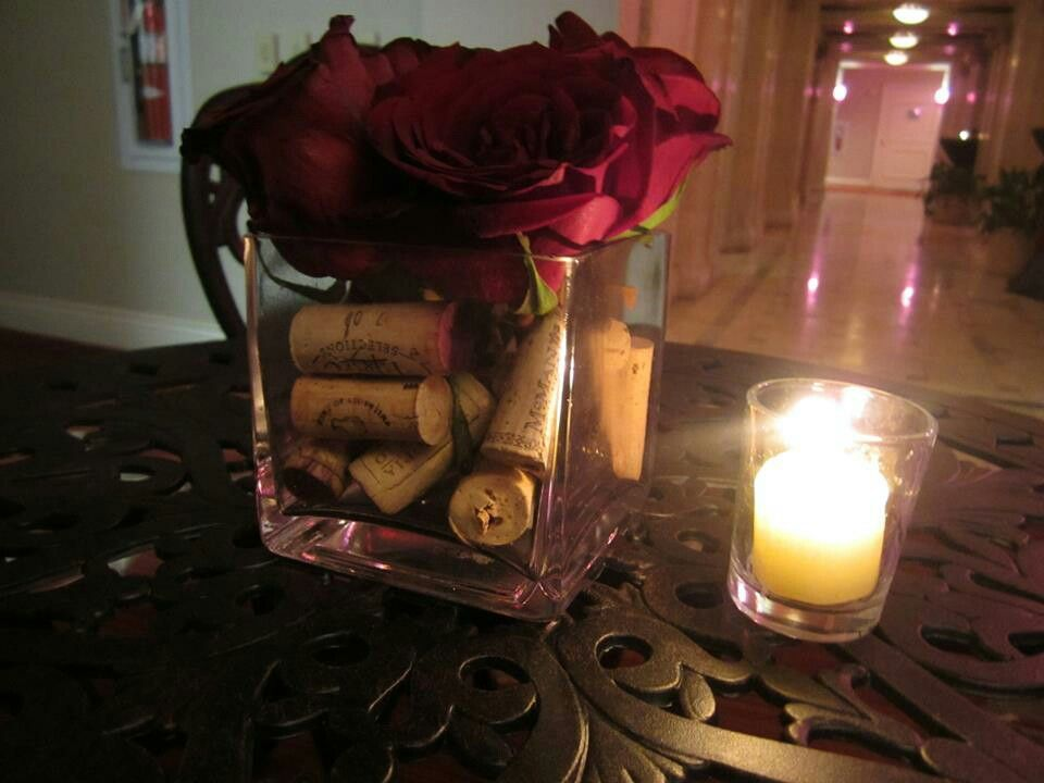 simple decorations with wine corks, flowers, and a candle! Available at your Pittsburgh area wedding with the help of Calla Event, Design. and Travel! Pennsylvania Weddings.  Get more info at http://callaeventdesign.squarespace.com