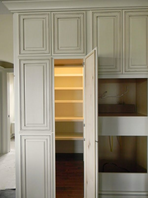 Love the idea of the walk in pantry looking like a cabinet for Hidden pantry doors