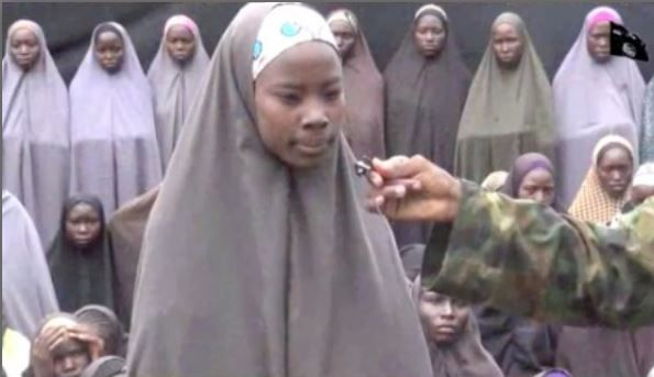 A screenshot of the video released by Boko Haram shows Esther Yakubu speaking…