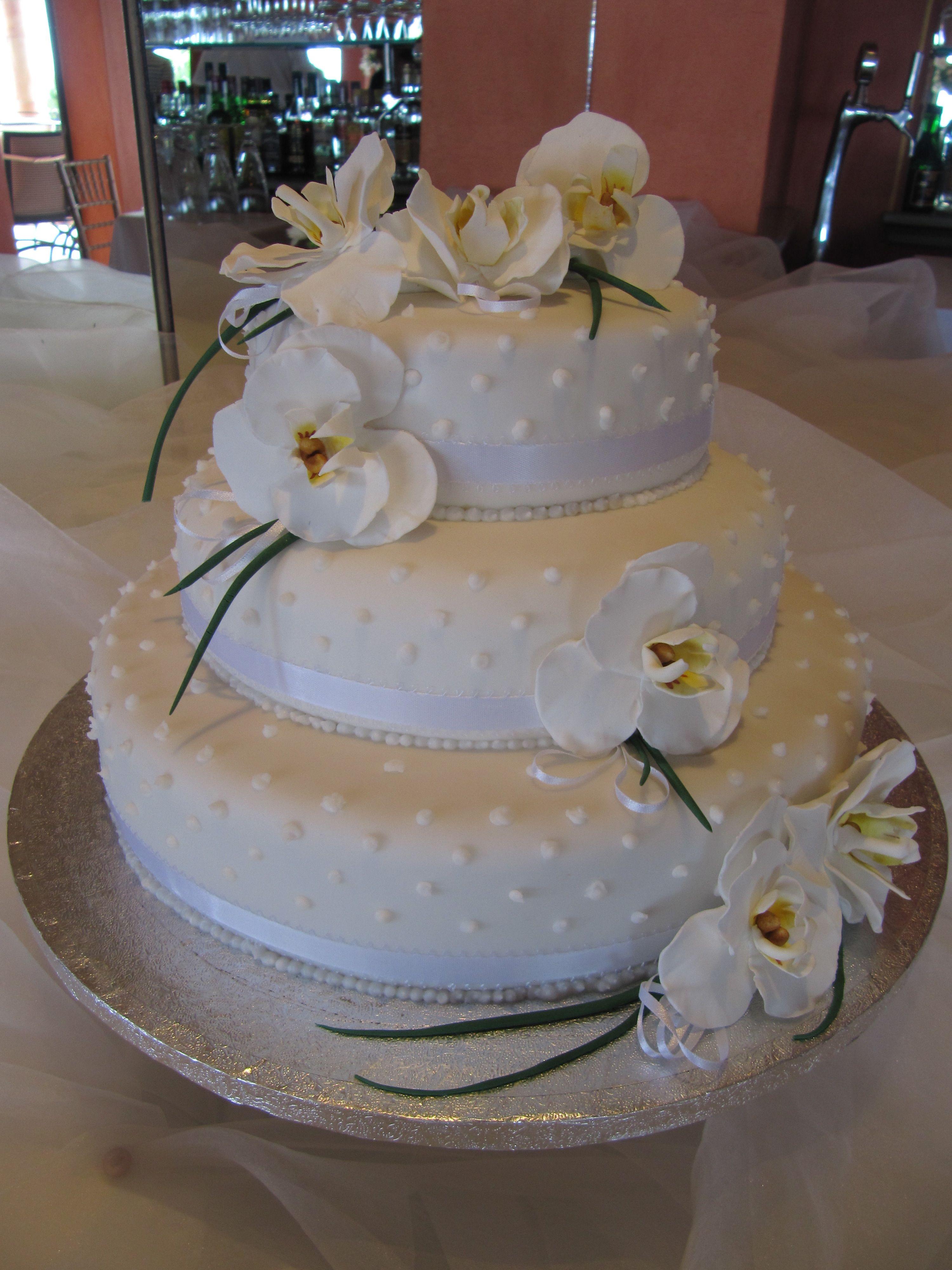 ©Algarve cakes. 3 tier wedding cake with handmade phalaenopsis orchids.