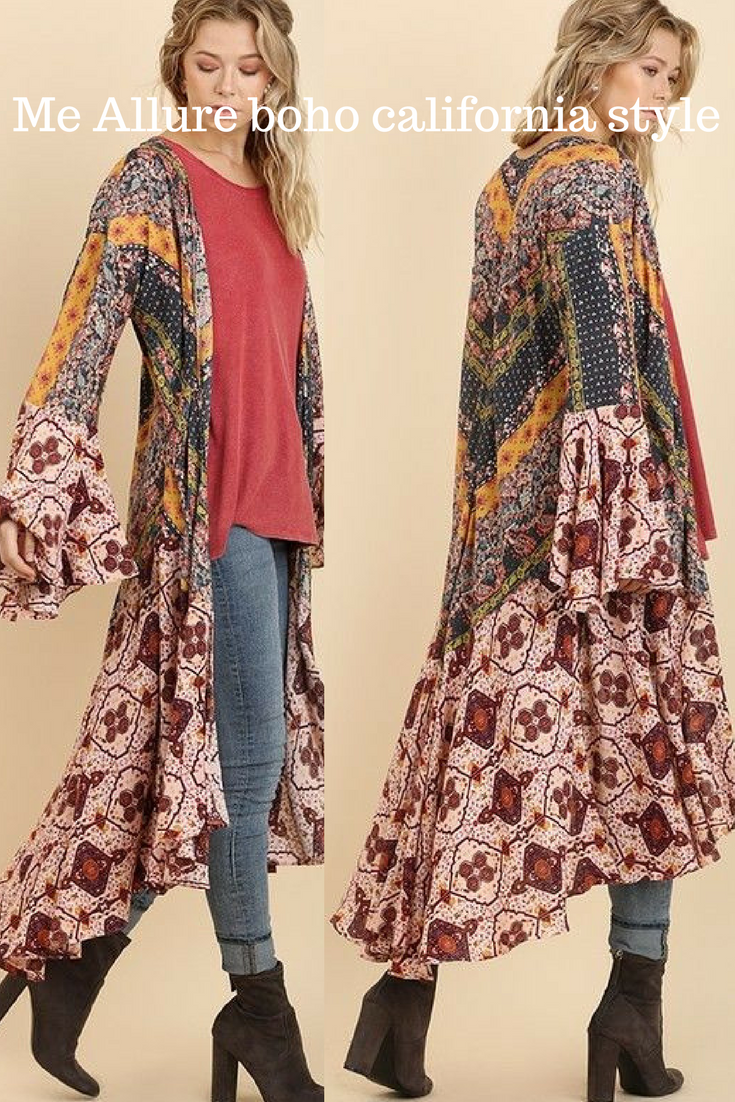 ec3ccc1693 This beautiful mixed floral print kimono is featured in an oversized maxi  silhouette.