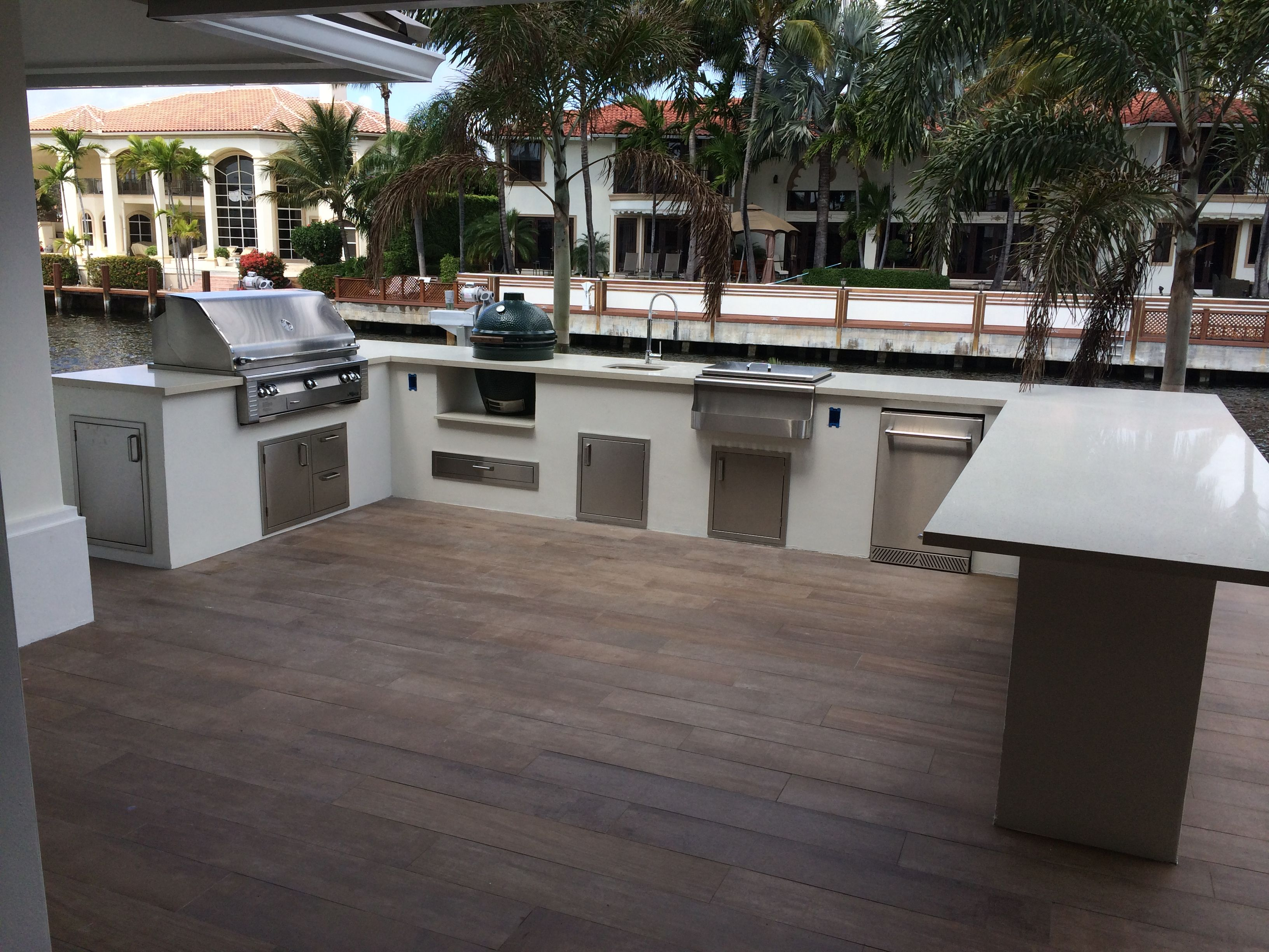 Custom outdoor kitchen with bar overhang and Big Green Egg