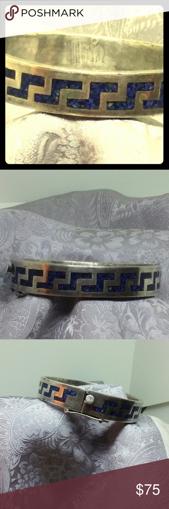 Sterling Silver Lapis Inlay Bangle Bracelet Vintage blue lapis lazily inlaid in sterling silver. It is marked but the maker is very hard to make out. Mexican? Native American? It is very good condition with no missing lapis stones and the locking clasp is working. Jewelry Bracelets