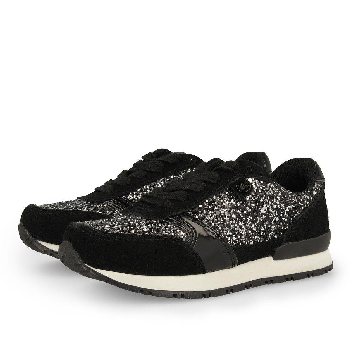 ff6d53ee Zapatillas deportivas en negro. Combinación de texturas en piel y con  efecto purpurina. Cierre con cordones. Corte combinado en piel y en  sintético.
