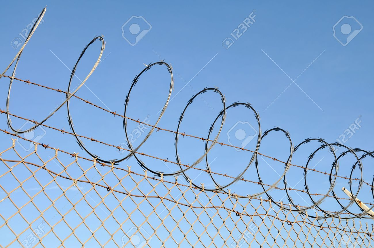 My new Pin 2534312-Security-fence-topped-with-barbed-and-razor-wire ...