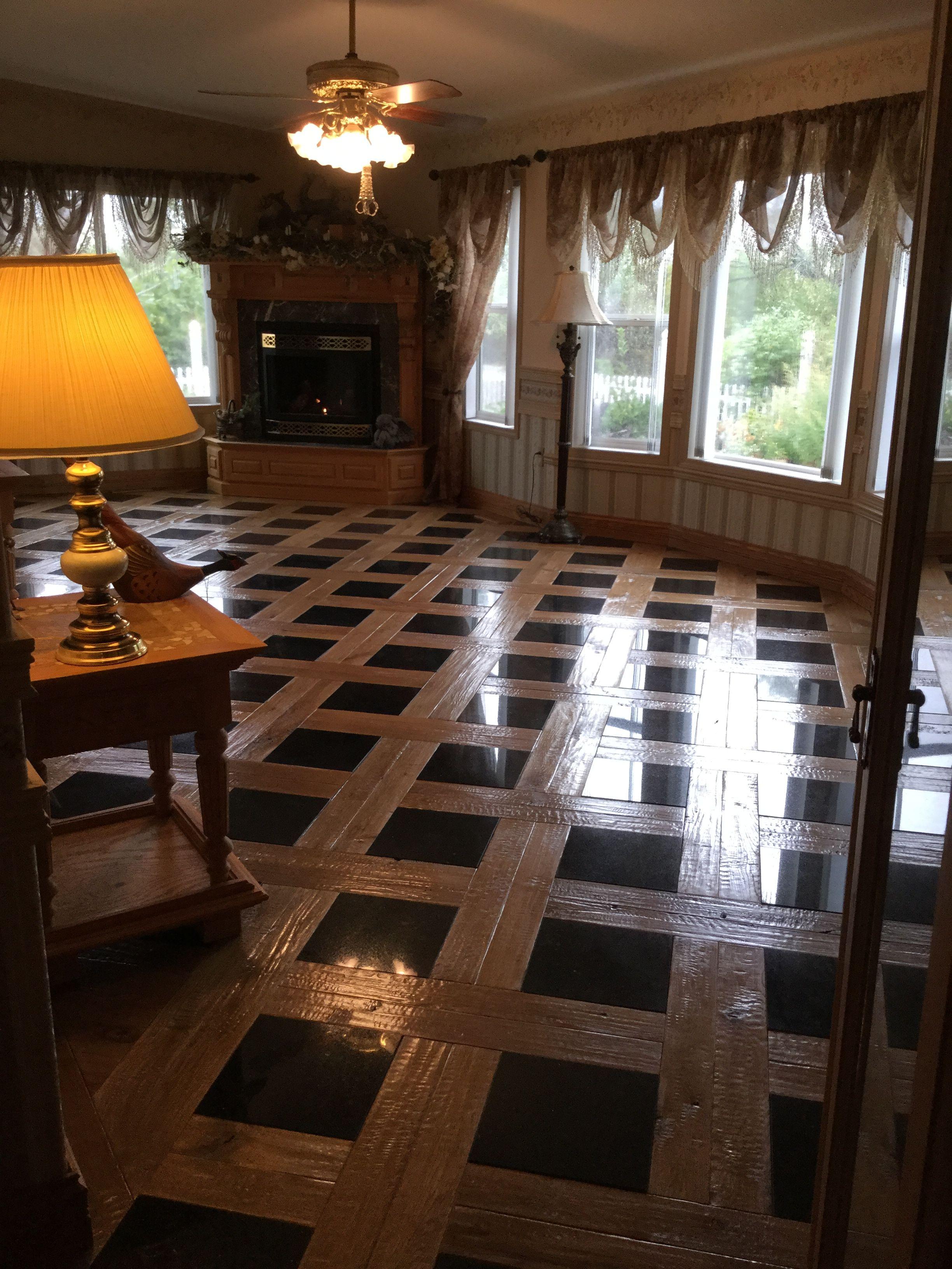 Living Room Floor Oak And Black Granite Tile Woman With Power Tools Floor Design House Flooring Granite Flooring