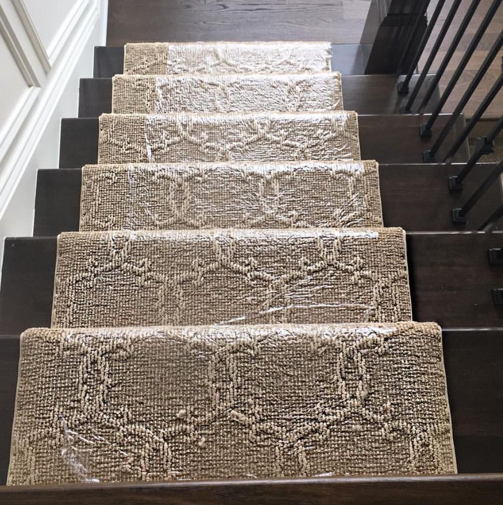 Patterned Carpet Runner On Dark Hardwood Stairs