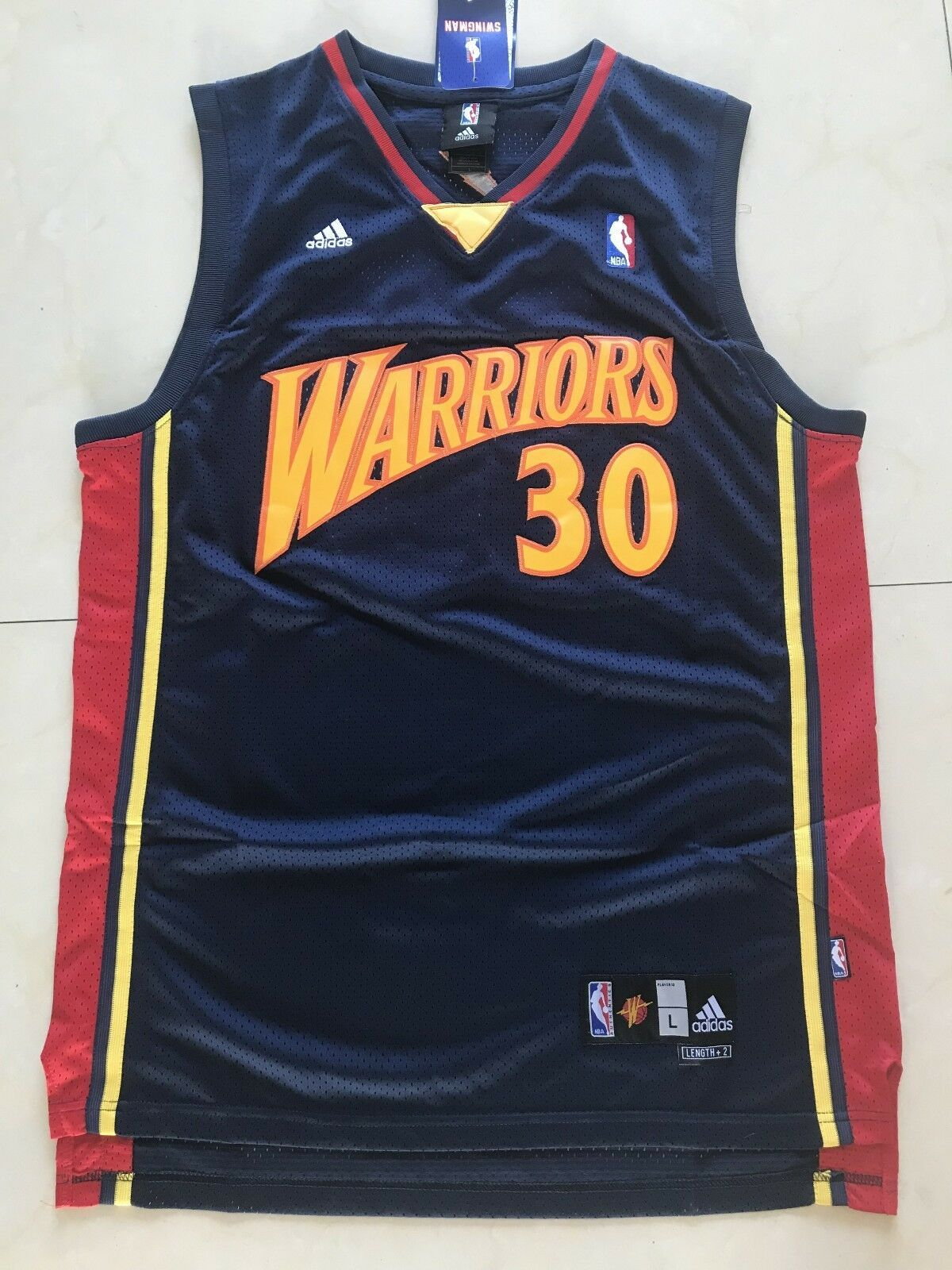 hot sale online 3ee89 a2ccd Men's Stephen Curry Golden State Warriors Throwback Swingman ...