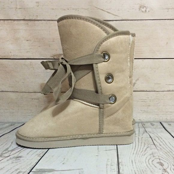 Beige Fuzzy Boots So cute and comfy. Fuzzy and warm on the inside. Ties in the front. Also available in black. This item is available. Don't forget to check out my Deal of the Month listing ! Shoes Winter & Rain Boots
