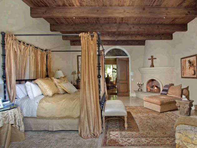 Master bedroom in luxury spanish style home in rancho - White colonial bedroom furniture ...