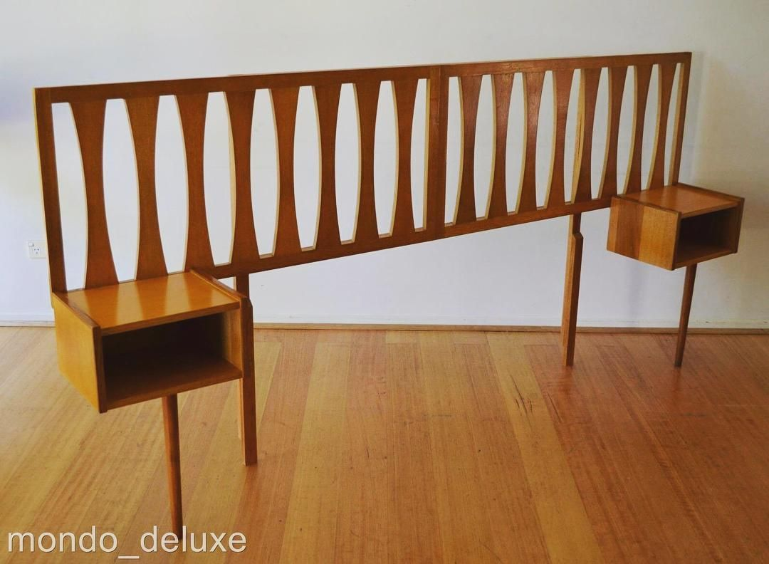 plenty of poles for the handcuffs. mid century oak bed head with
