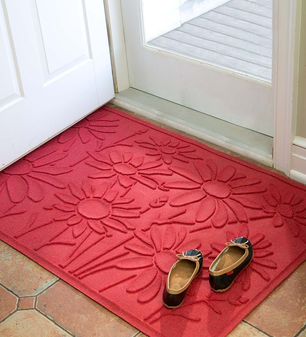 Cheerful daisies decorate this heavy-duty doormat. It's mold and ...