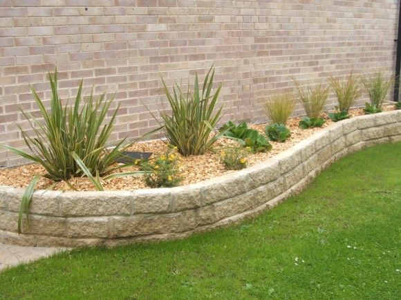 Curved Garden Lawn With Raised Wall Beds For Low Maintenance