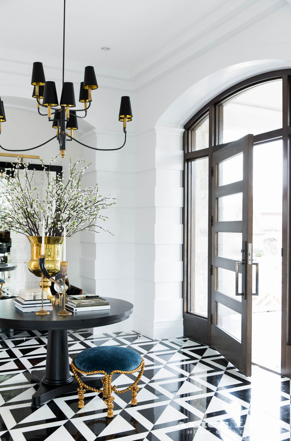 Contemporary black and white tile floor in this stunning entryway alice lane