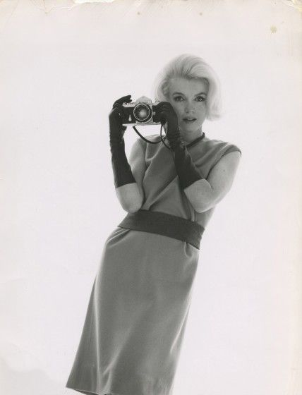 Marilyn Monroe with a Nikon F by Bert Stern, 1962.