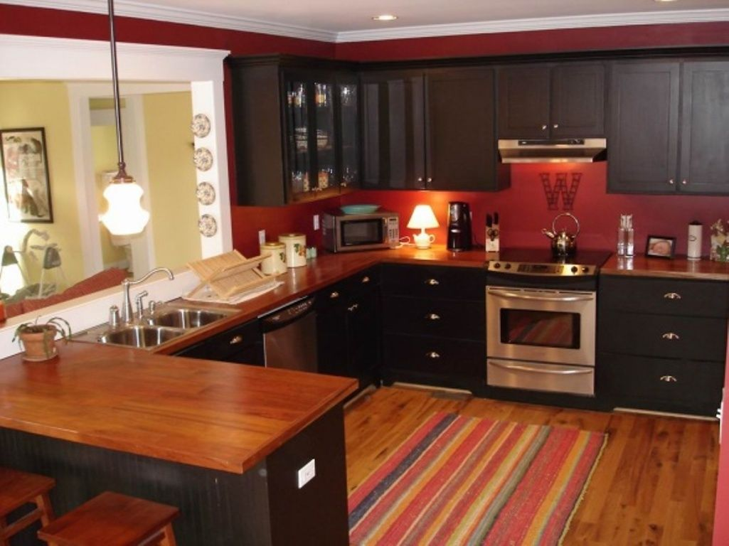 Pin By Cat Kafka On For The Home Red Kitchen Walls Red Kitchen Cabinets Kitchen Cabinets With Black Appliances