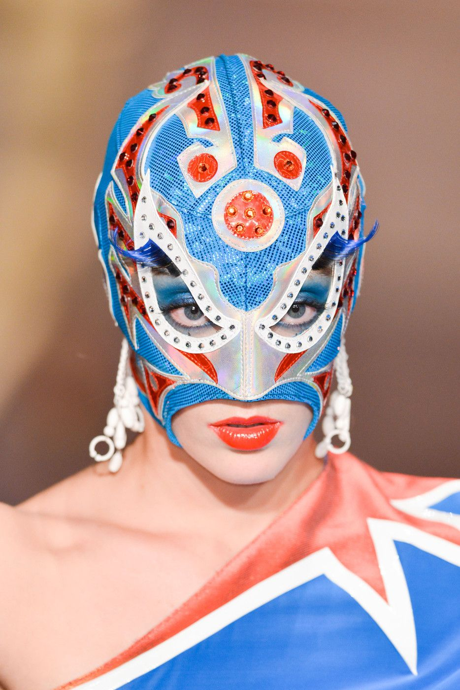 Another look we were inspired by at Jean Paul Gaultier? These lucha libre–style masks.