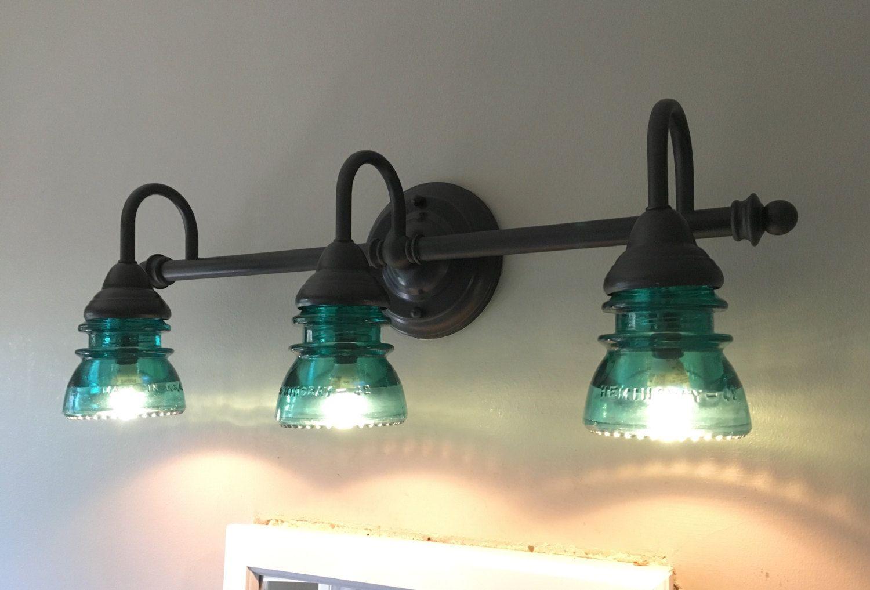 3 Light Bathroom Vanity Fixture With Clear Vintage Glass Insulator Lights Vintage Bathroom Lighting Glass Insulators
