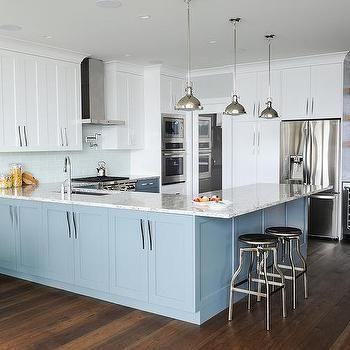 White and blue kitchen with light glass tile backsplash also