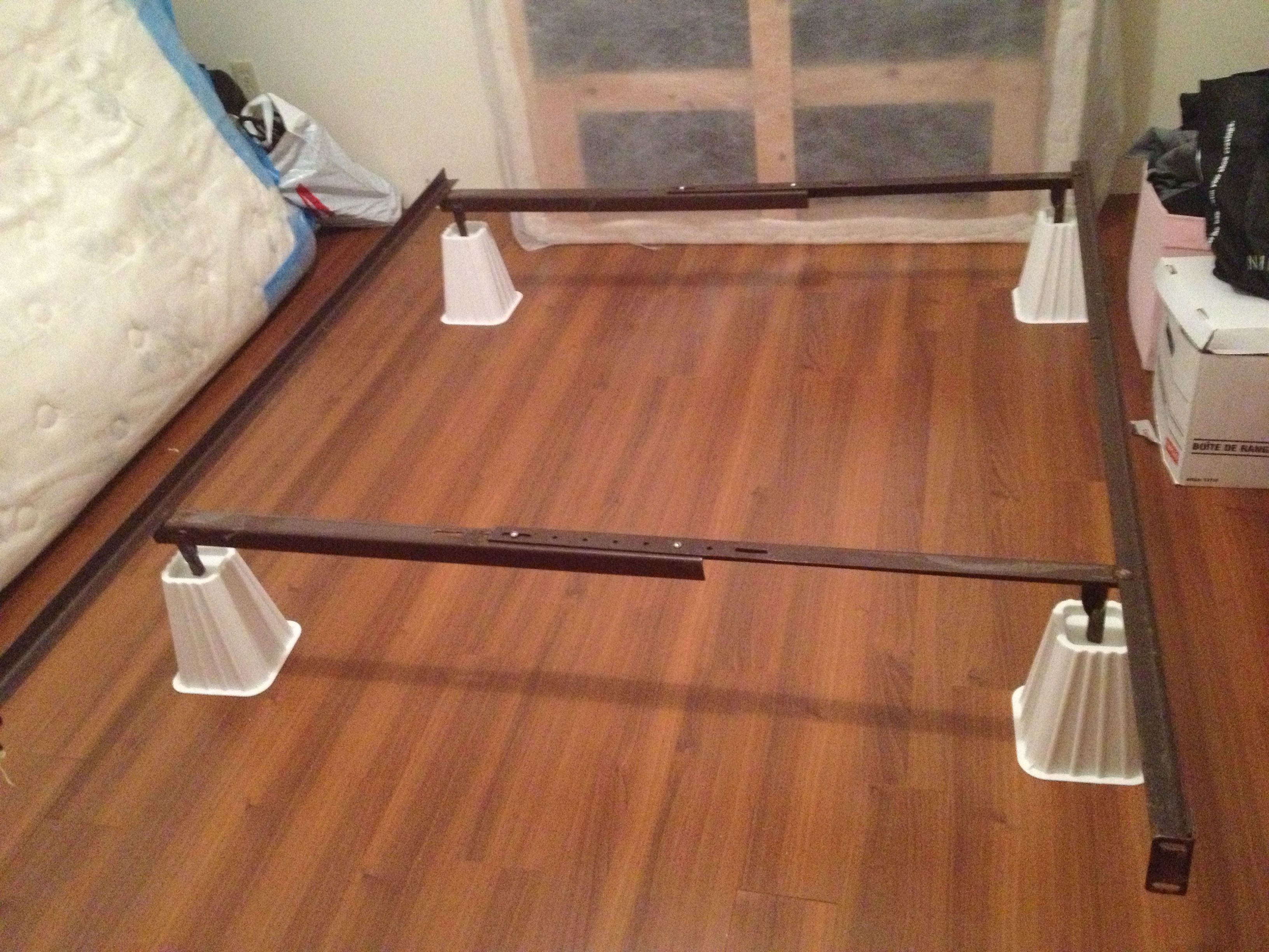 Metal bed frame on white bed risers for extra under the bed storage ...