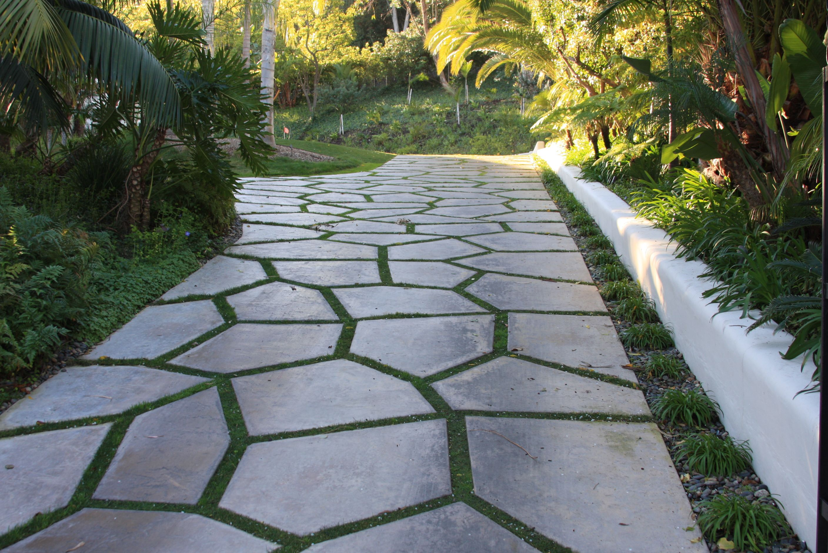 Natural stone with a grass divider by sc interlocking for Lawn divider