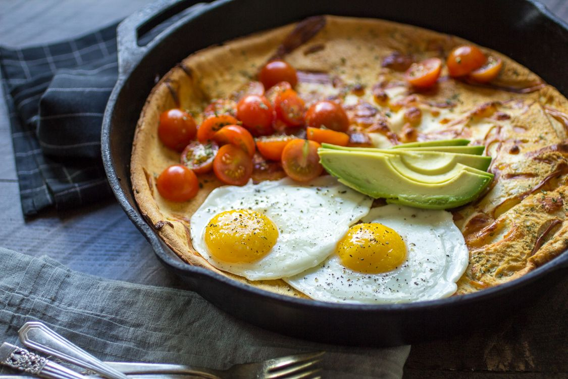This Savory Dutch Baby is loaded with cheese and topped ...