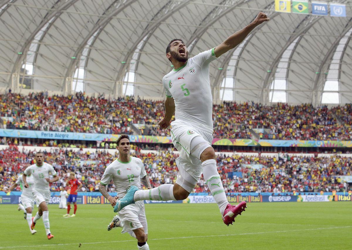 Algeria's Rafik Halliche (5) celebrates after scoring his ...