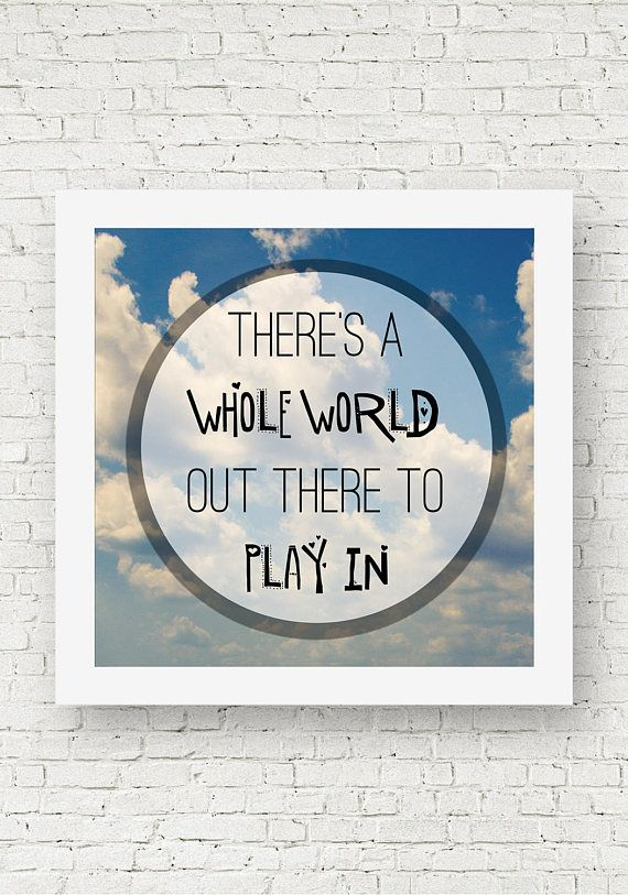 "A square quote print that says, ""There's a whole world out there to play in,"" with clouds and a blue sky in the background."
