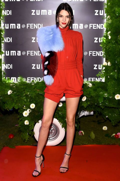 In a Fendi romper and fur stole with black strappy sandals at a Fendi event in Rome, Italy.