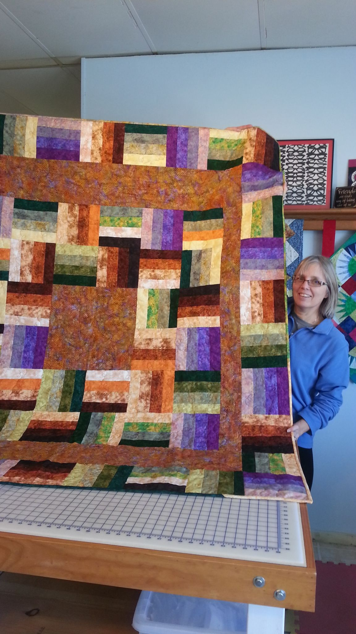 This is Jeannie's first quilt from our beginning quilting class.  We are so proud of her.