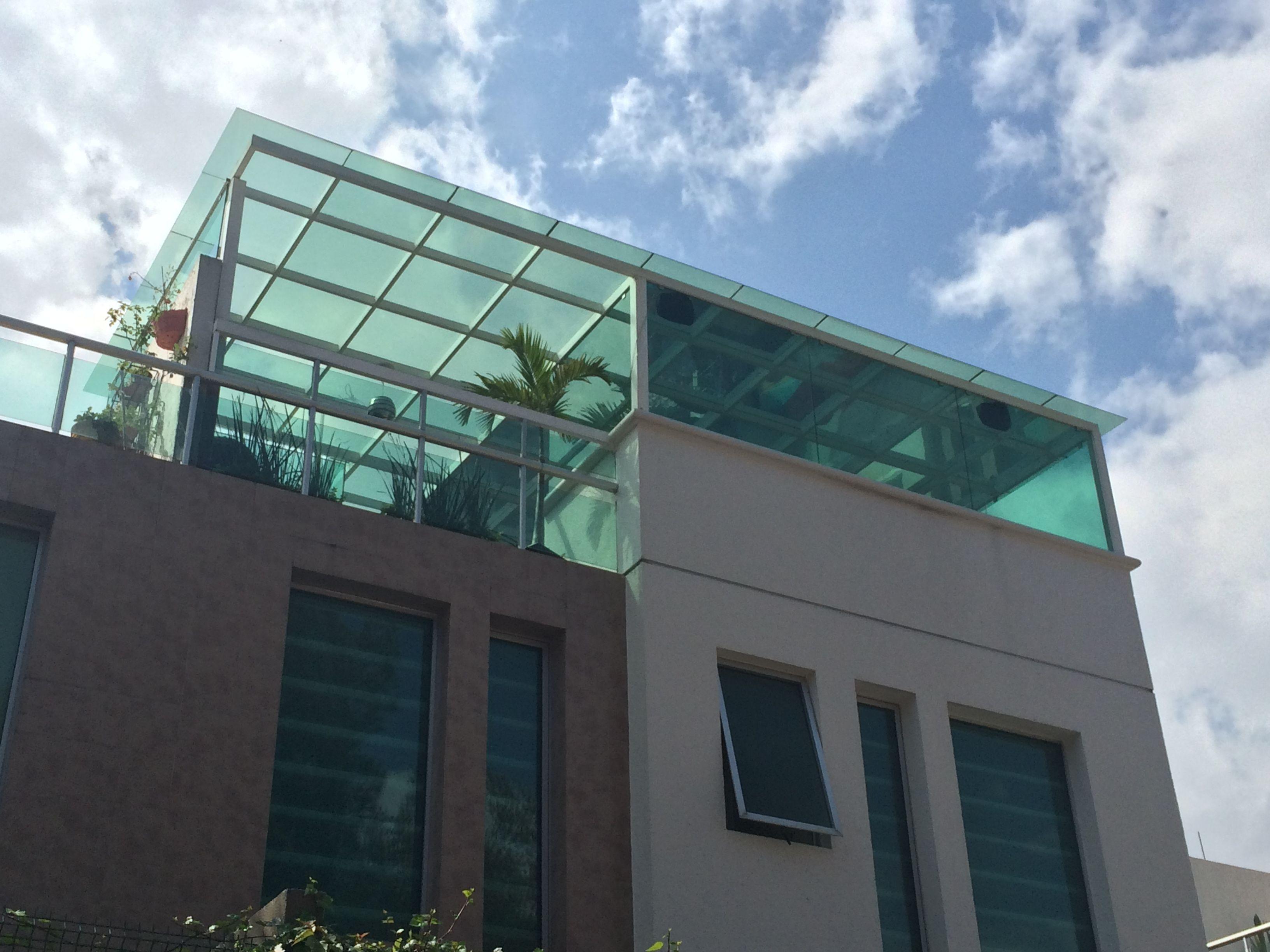 Roof garden con domo de cristal simplemente un espacio - Cerrar escalera caracol ...