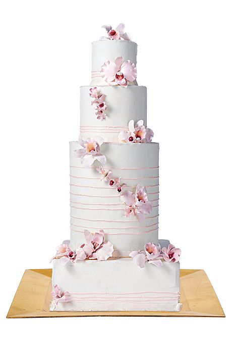 A glamorous city wedding calls for an equally outstanding cake. This four-tier cake has the right amount of height to make a statement, while the orchids and stripes infuse it with wedding-worthy romance.  White four-tier cake with thin pink stripes and sugar orchids, $12 per slice (serves 80) One Girl Cakes.
