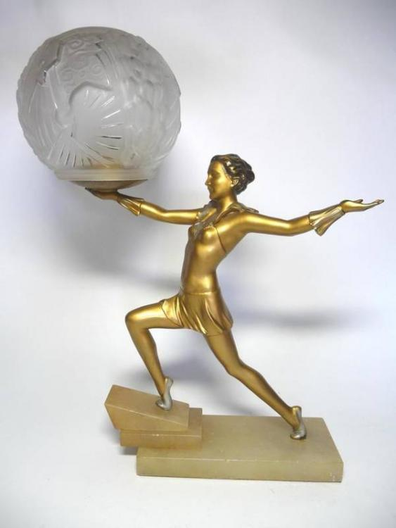 An Art Deco Gilt Patinated Spelter Figural Lamp, modelled