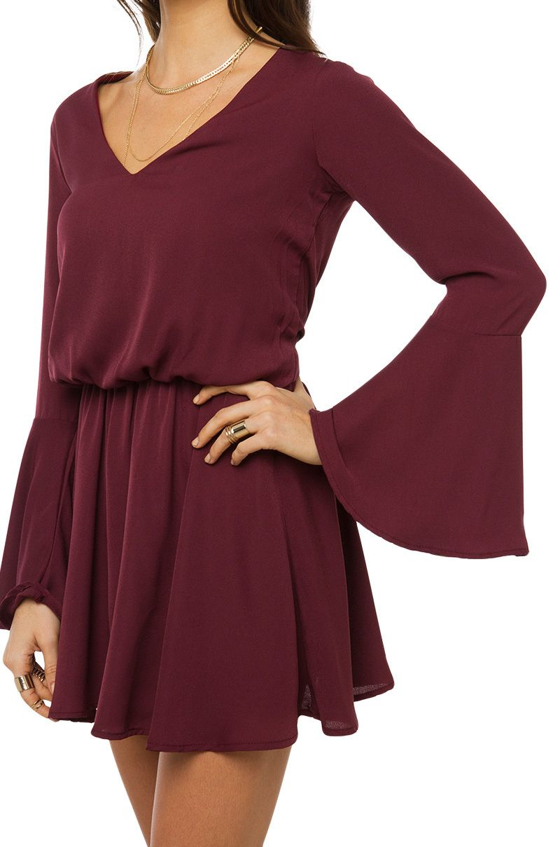 deac8908ae6d The Drop Waist Flowy Dress in Wine features a deep v-neckline