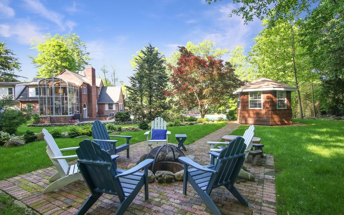 expansive patio, fire pit and lush landscaped grounds ... on For Living Lawrence Fire Pit id=68041