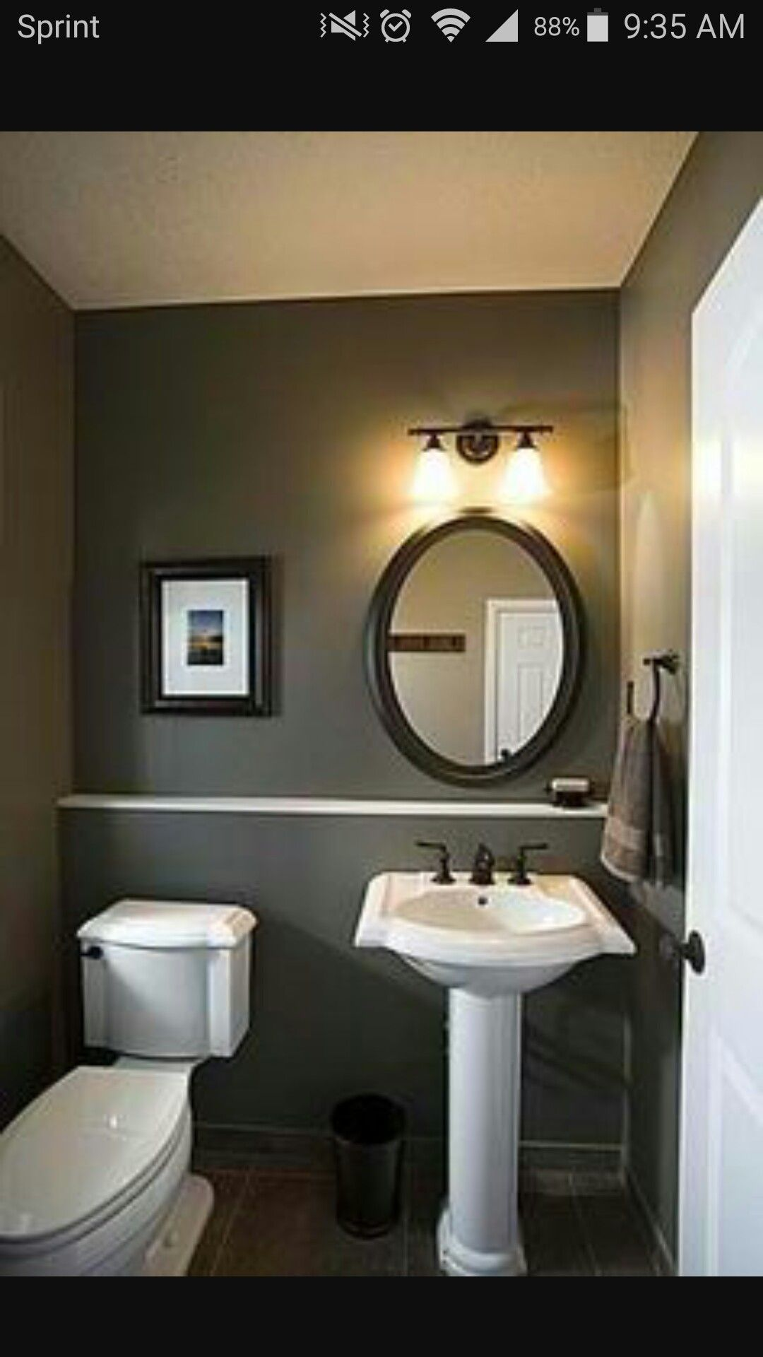 Love the dark color. Dark trash bin. With oval mirror vs ...