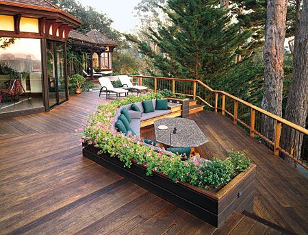 Clever way to integrate planter into two level deck.  Also, changing direction on decking makes nice definition.
