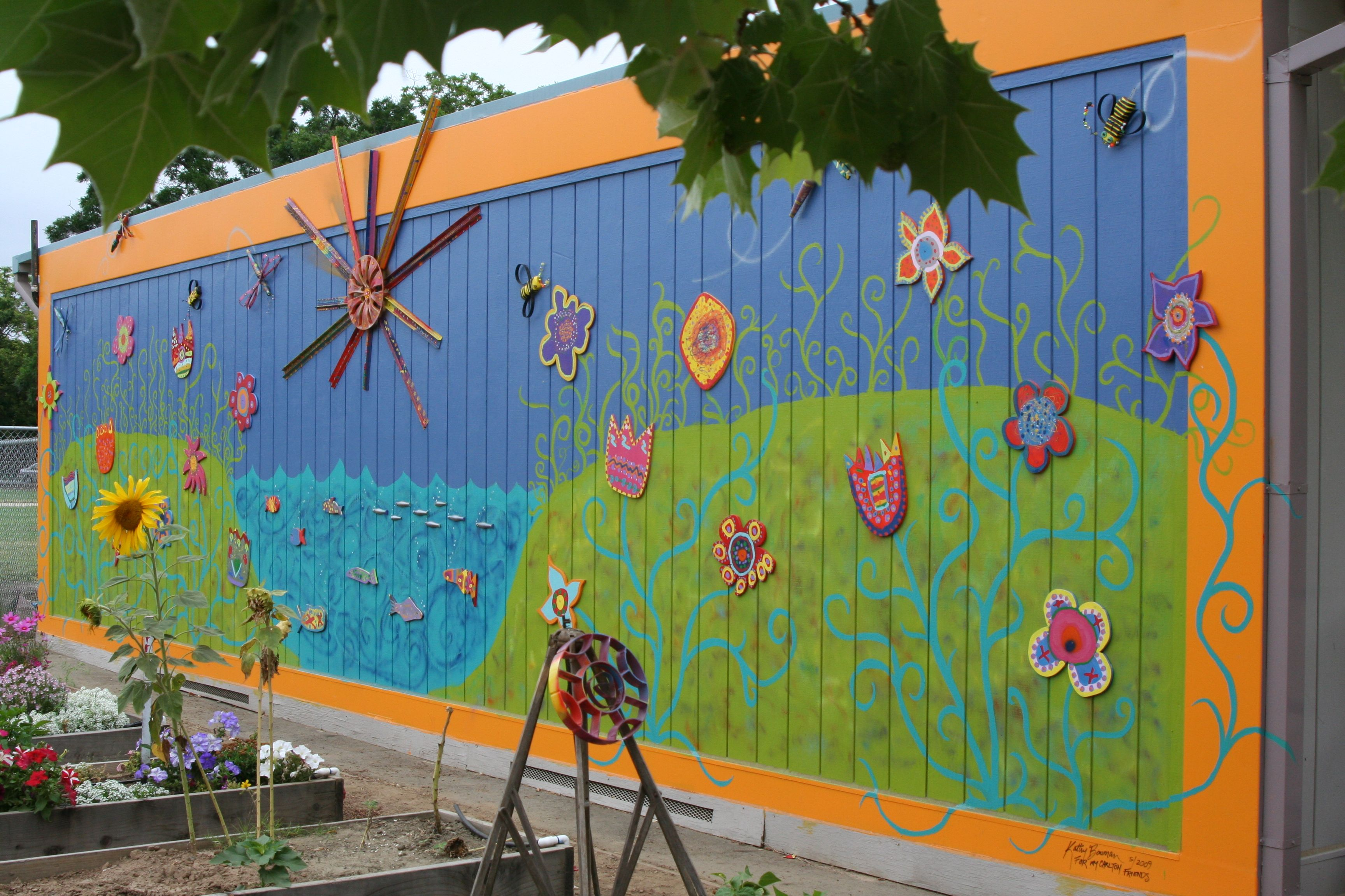 A Mural Painted At A School The Sun Dragonflies Bees