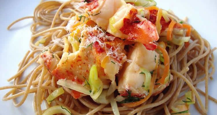 Yum ! Fresh baked lobster chunks with bamboo shoots, sprouts, kale, parsley and thin pasta ! Delicious !