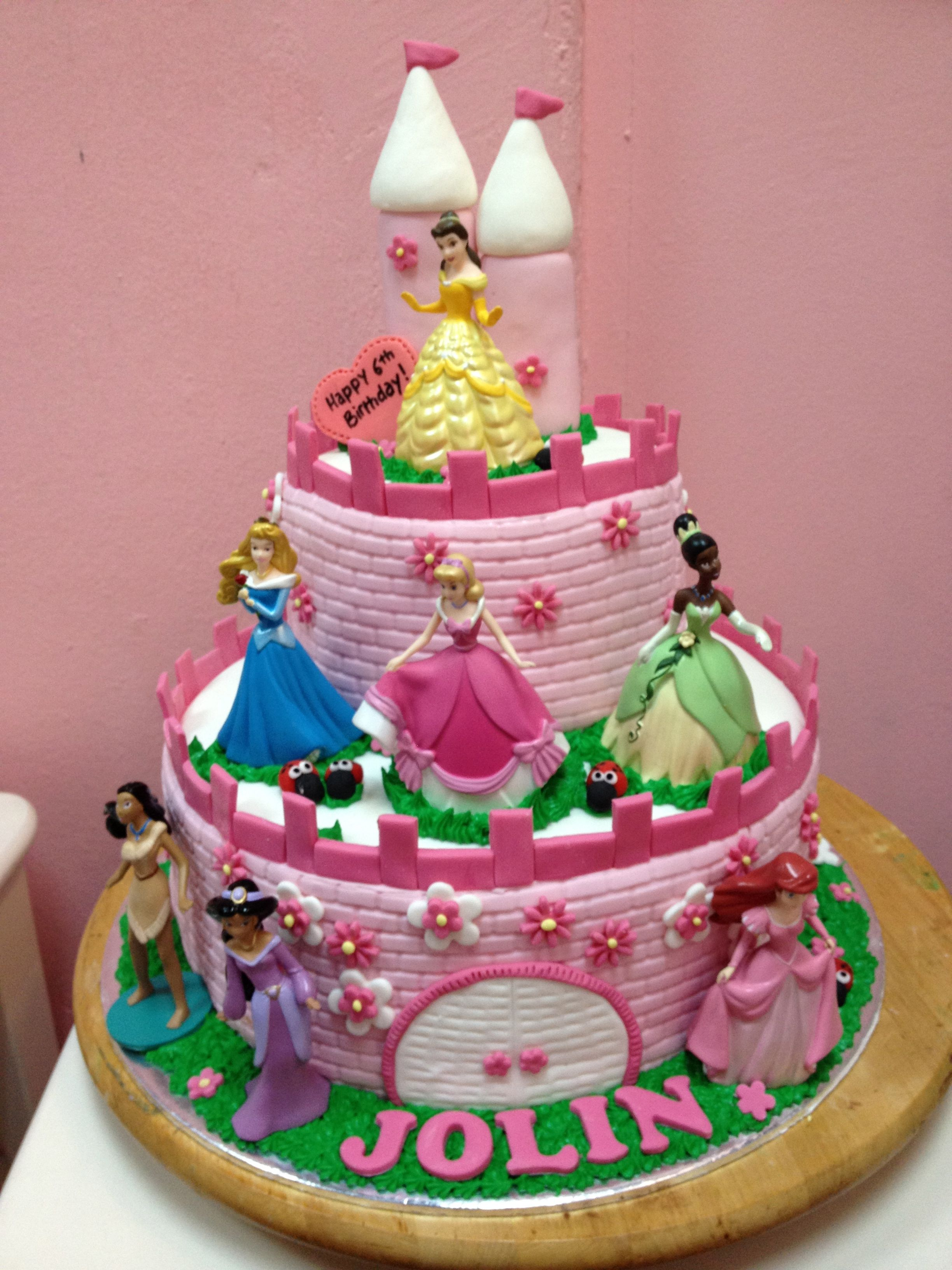 2 tier princess castle cake with disney toppers provided by customer
