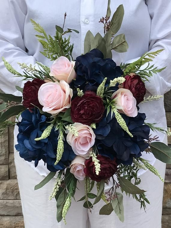 Navy Burgundy and Blush Bridal Bouquet-Navy Silk bridal Bouquet-Navy Hydrangeas-Burgundy Ranunculus-Roses-Navy Silk Wedding Bridal Bouquet #silkbridalbouquet Beautiful boho silk bridal bouquet in navy, burgundy and blush. This beautiful bouquet is made with silk flowers in navy, burgundy and blush. Hydrangeas, ranunculus, heather and roses are tucked among the eucalyptus and greenery. With an approximate finished dimension of 20x22 inches, you can choose #silkbridalbouquet