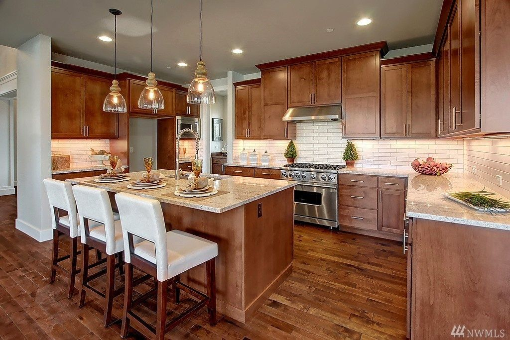 Brown Cabinets Clear Lights Counters Brown Kitchen Cabinets