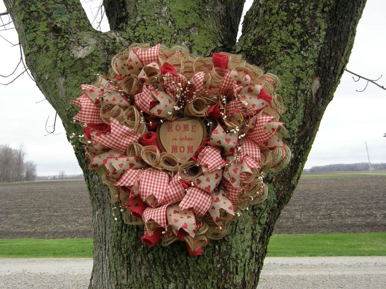 A personal favorite from my Etsy shop https://www.etsy.com/listing/217606491/primitive-burlap-mesh-mothers-day-wreath