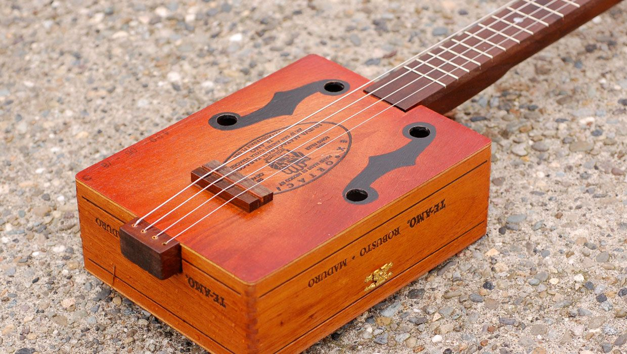 family fun how to make a guitar out of a cigar box craft box guitar cigar box guitar. Black Bedroom Furniture Sets. Home Design Ideas