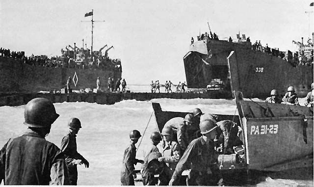 """Pontoon causeway to unload LSTs (Landing Ship, Tank) at Gela in the July 1943 Allied invasion of Sicily. In """"With Every Letter,"""" Lt. Tom MacGilliver lands at Gela."""
